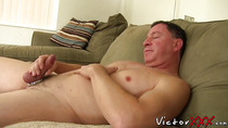 Freaky guy with a cock ring masturbates and toys his ass