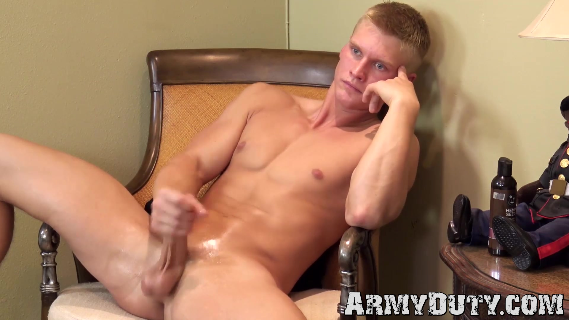 Black dude tugs his long cock