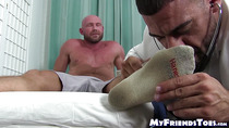 Hunky doctor sucks and fucks his handsome patients feet