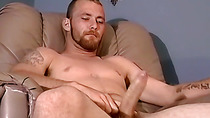 Bearded amateur filmed watching porn and stroking his cock
